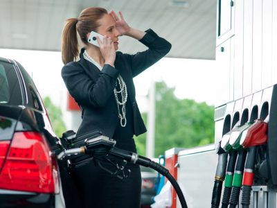 a woman at a gas station